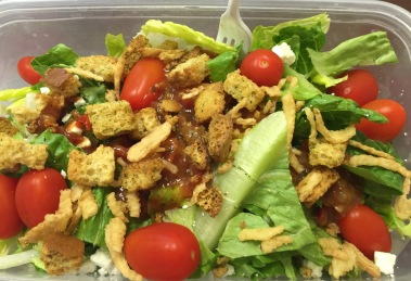 Lunch salad! cherry tomatoes, feta cheese, croutons, fried onions, and mango salsa atop romaine lettuce.