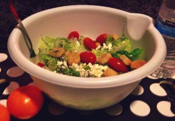 Giant salad made with: romaine lettuce, cherry tomatoes, feta cheese, chia seeds, and croutons; with clementines and lemon-infused water on the side. Tasty!