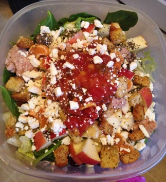 Romaine and spinach topped with feta cheese, grapes, apples, clementines, avocado, chia seeds, croutons, tuna, and mango salsa